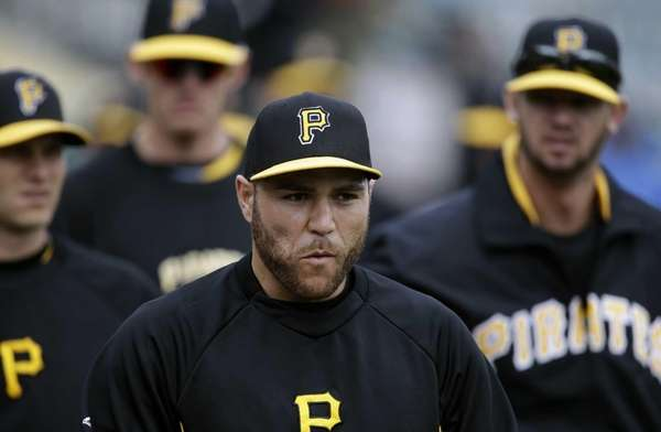 Pittsburgh Pirates catcher Russell Martin, center, walks on