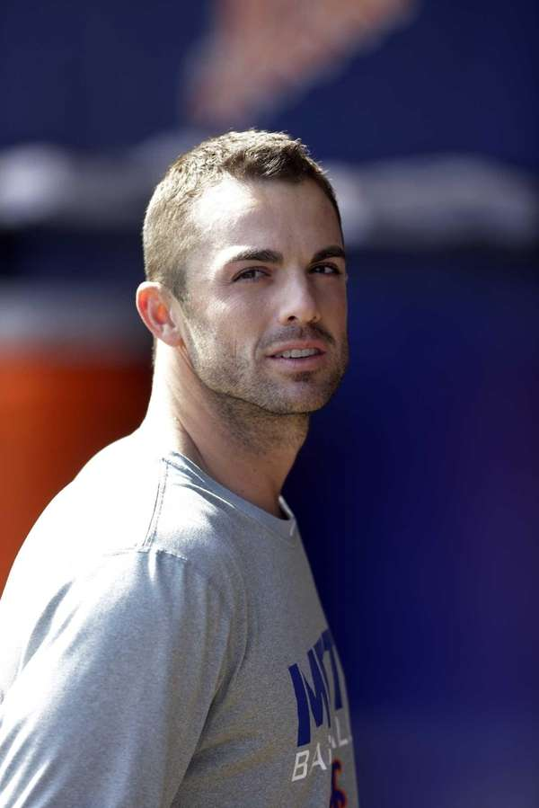 David Wright stands in the dugout before a