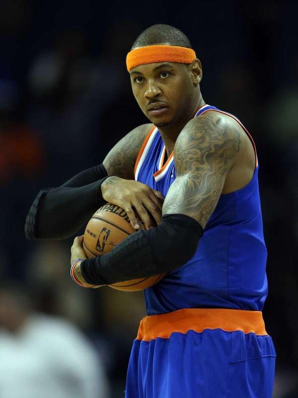 Knicks star Carmelo Anthony holds the ball before