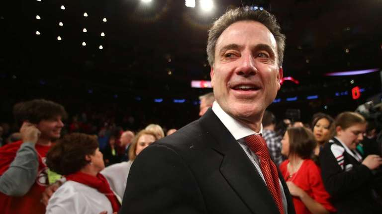 Louisville head coach Rick Pitino celebrates after beating