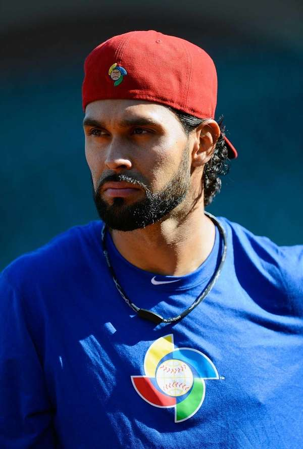 Puerto Rico's Angel Pagan watches Japan take batting