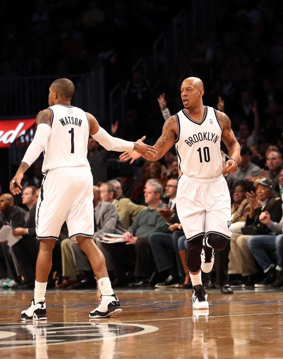 C.J. Watson congratulates Keith Bogans #10 on his