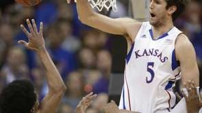 Kansas center Jeff Withey blocks a shot by