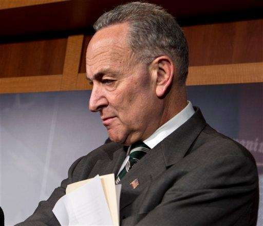 Sen. Charles Schumer, D-N.Y. listens during a news