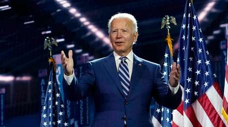 Former Vice President Joe Biden stands on stage