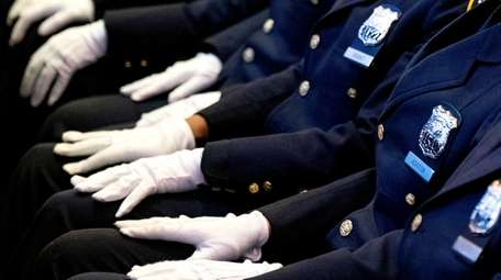 Graduates of the NYPD Police Academy attend their