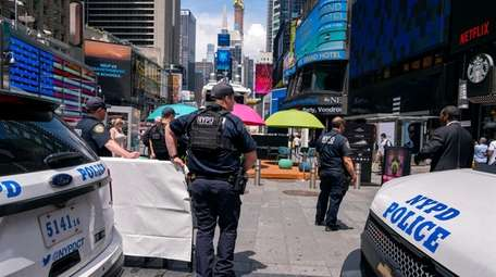 NYPD officers patrol Times Square in Manhattan in