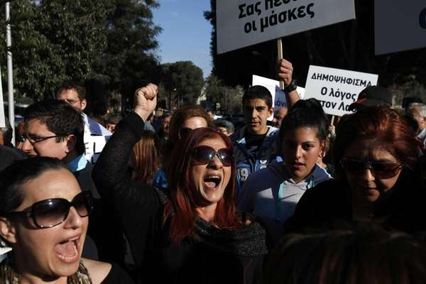 Protesters shout slogans during a protest outside of