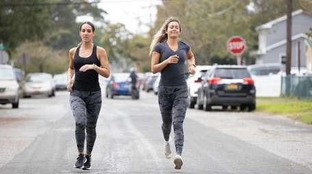 Sisters GinaMarie and Erica Ferretti workout together near