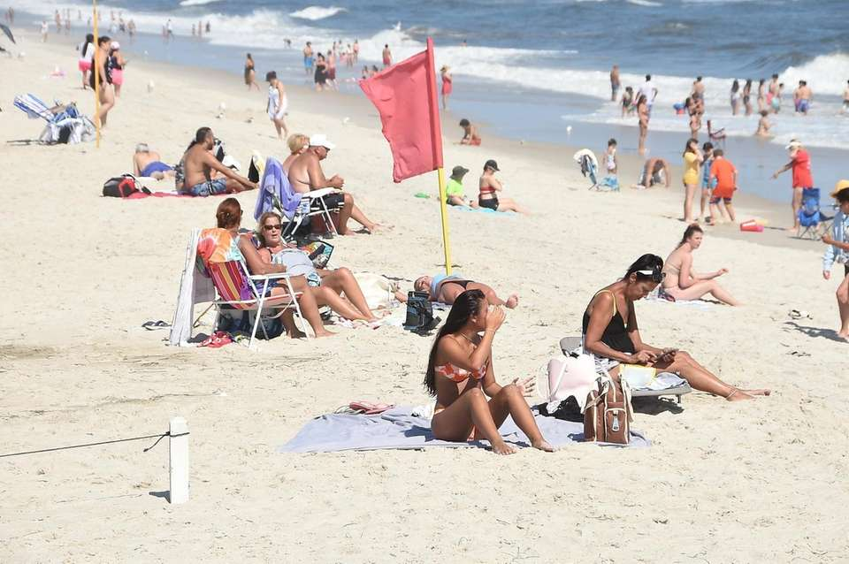 People relaxing on the beach on Robert Moses