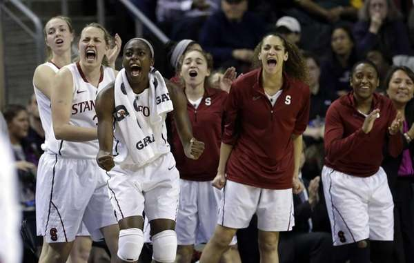 Stanford players react on the bench as the