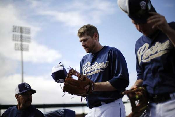 Padres third baseman Chase Headley, center, walks to
