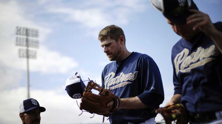 Padres third baseman Chase Headley, center, walks to