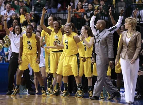 The Baylor bench, from left, Destiny Williams (10),