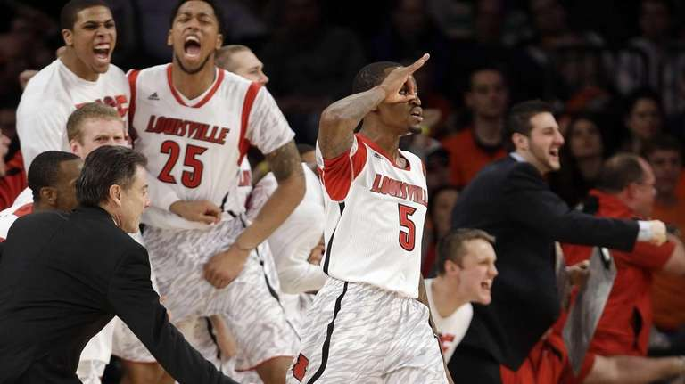 Louisville's Kevin Ware (5) celebrates after making a