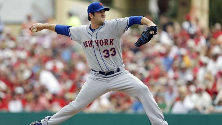 Matt Harvey delivers a pitch during the first