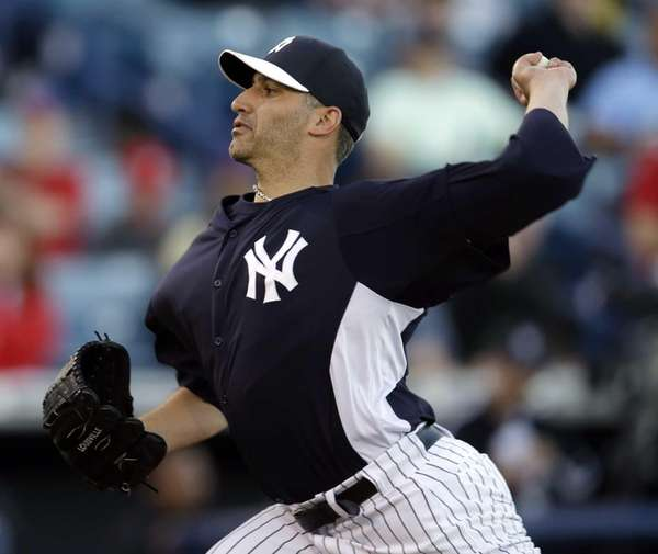 Andy Pettitte delivers a pitch in the first