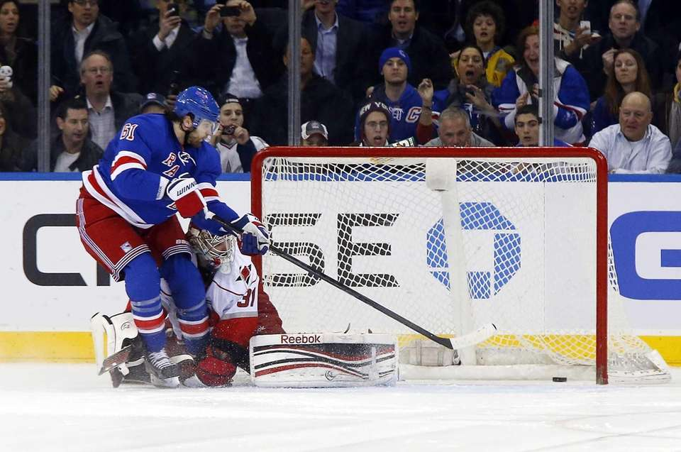 Rick Nash scores a shoot out goal past