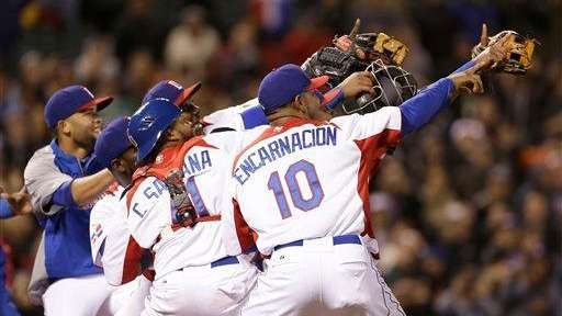 The Dominican Republic team celebrates after beating the