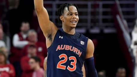 Auburn's Isaac Okoro celebrates after Auburn defeated Arkansas