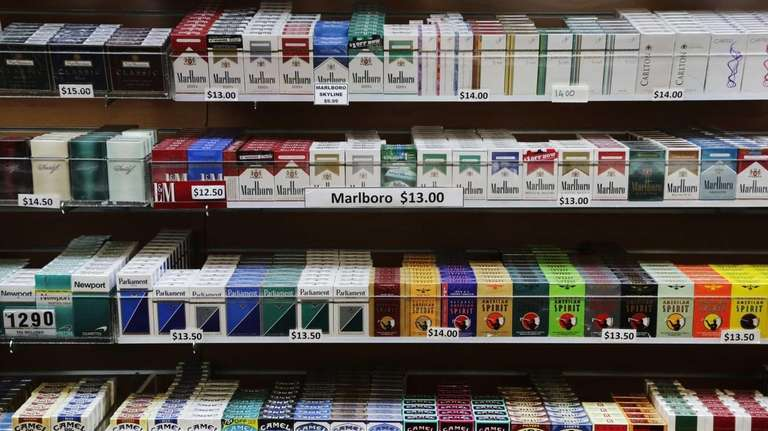 Cigarette packs are displayed at a smoke shop