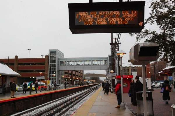Commuters wait for their trains in Mineola as