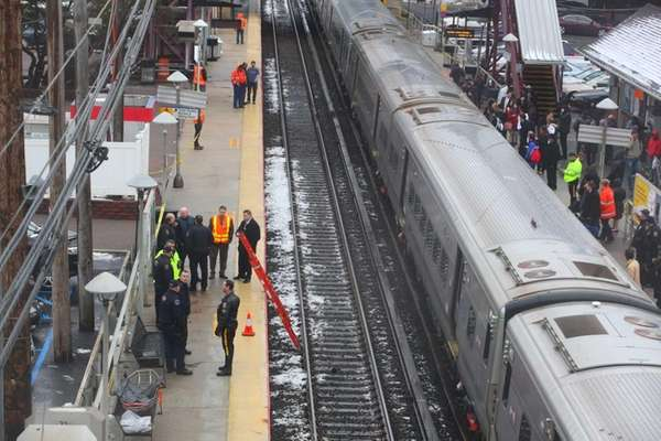 Police investigate the scene on the westbound LIRR