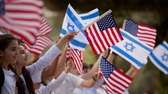 Israeli children wave flags during a rehearsal, a