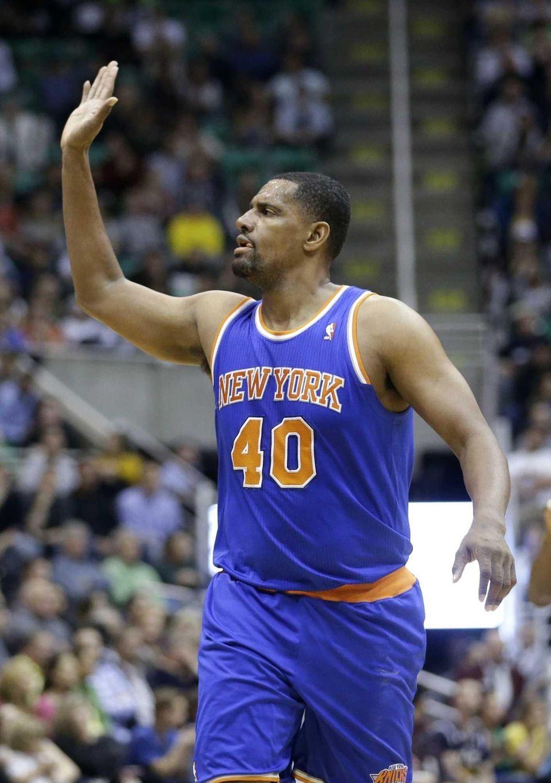 Kurt Thomas (40) raises his hand for a