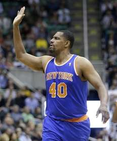 Kurt Thomas (40) raises his hand for a