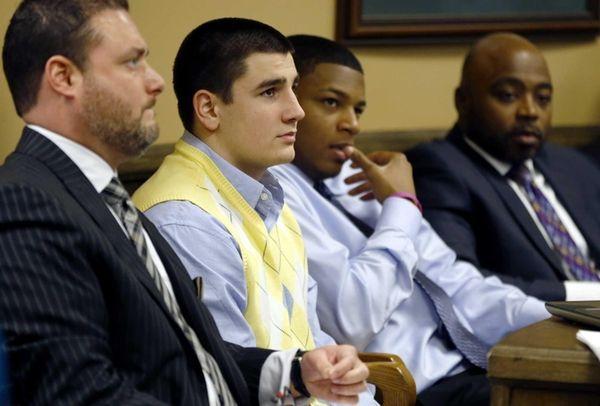 From left, Defense attorney Adam Nemann, his client,