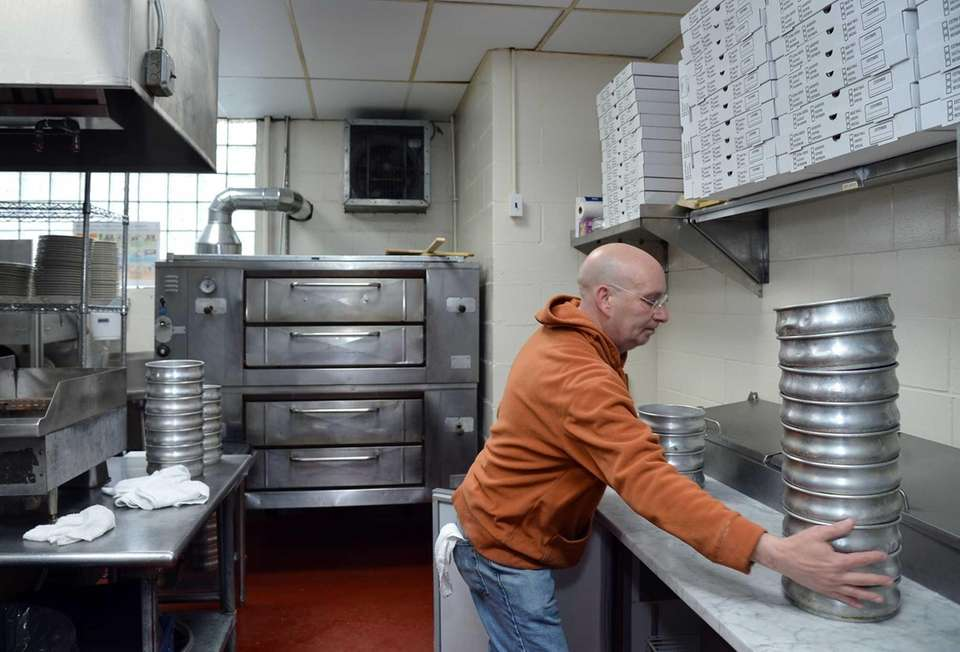 Phil Labozzetta, the pizza chef, stores fresh pizza