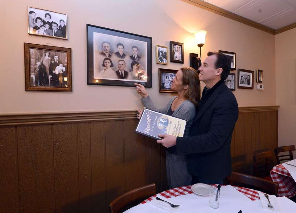 Helene and Tom Suozzi look at photos of