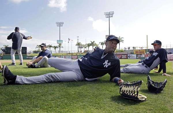 Derek Jeter stretches before a spring training game