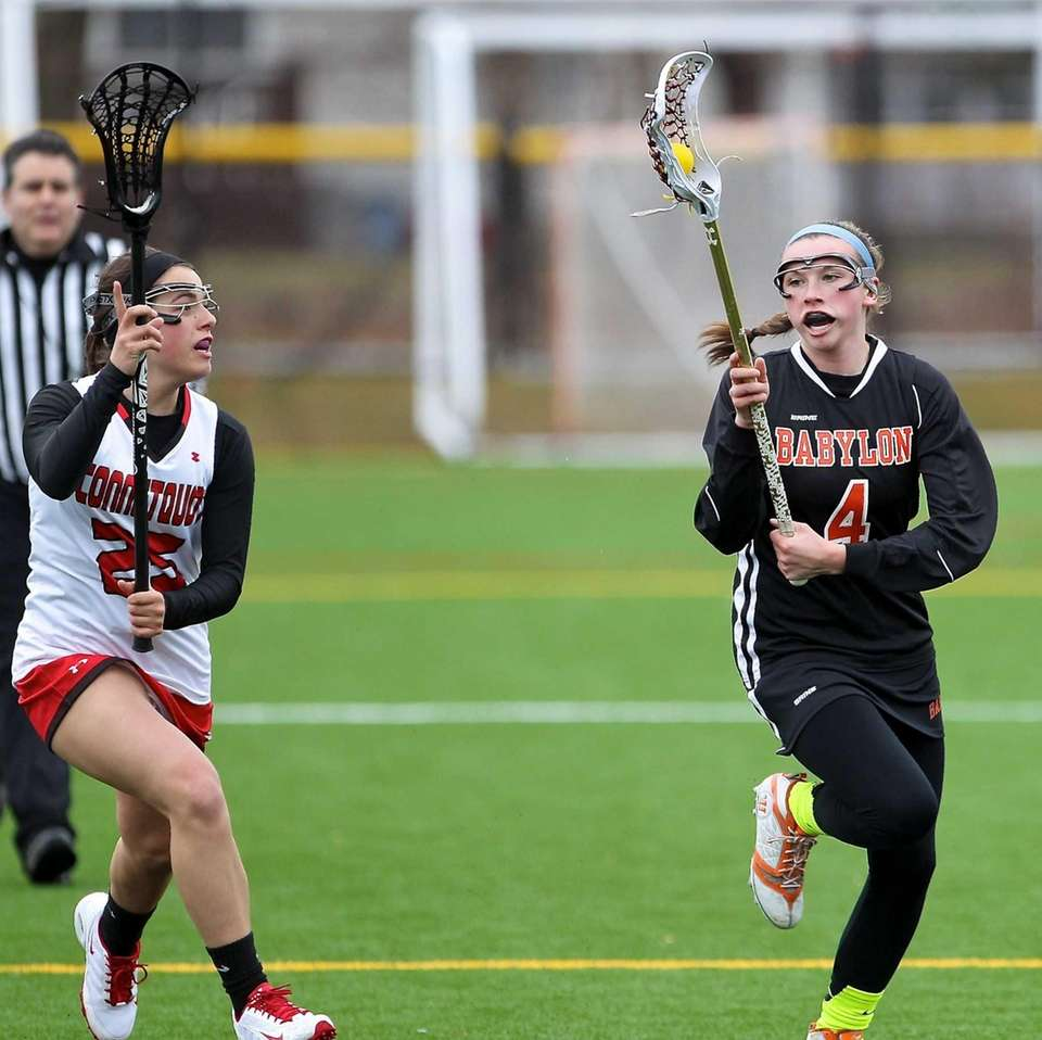 Babylon's Kaileen Hart moves the ball past Connetquot's