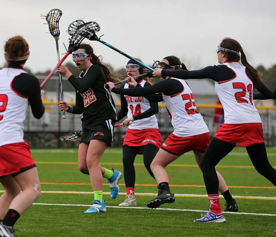 Babylon's Shannon Hartigan fights off three Connetquot defenders