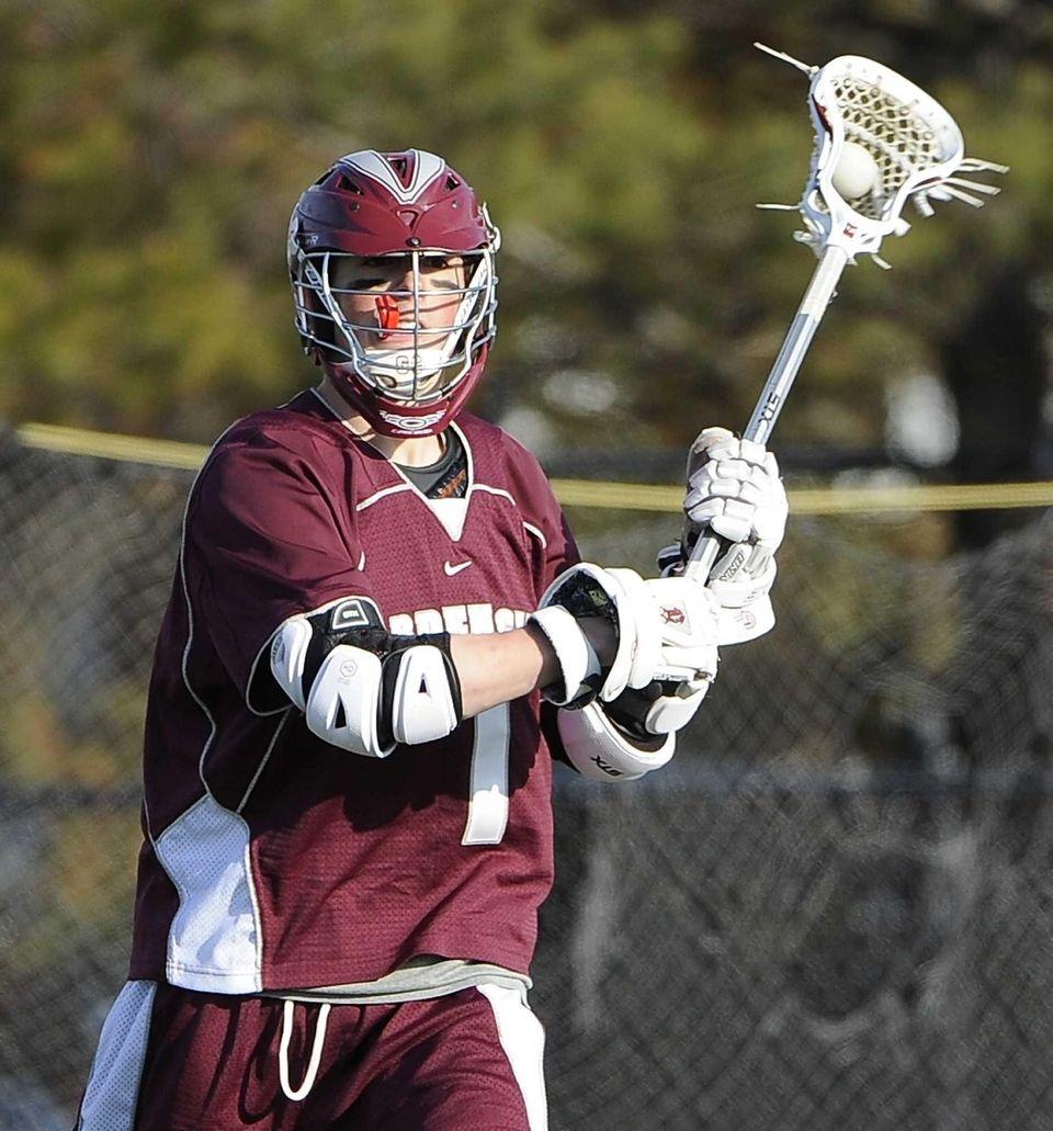 Garden City attacker Justin Guterding controls the ball