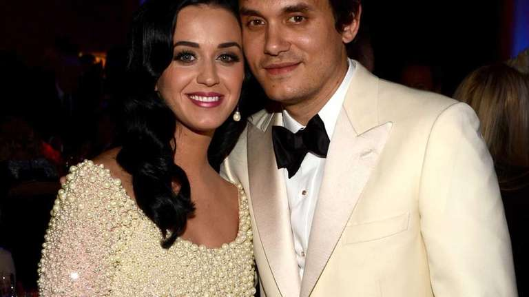 Singers Katy Perry and John Mayer attend the