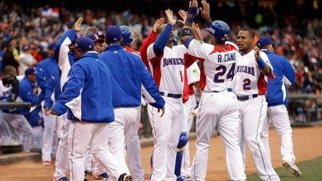 Robinson Cano of the Dominican Republic celebrates with