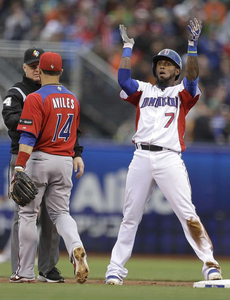 Dominican Republic's Jose Reyes celebrates after hitting a