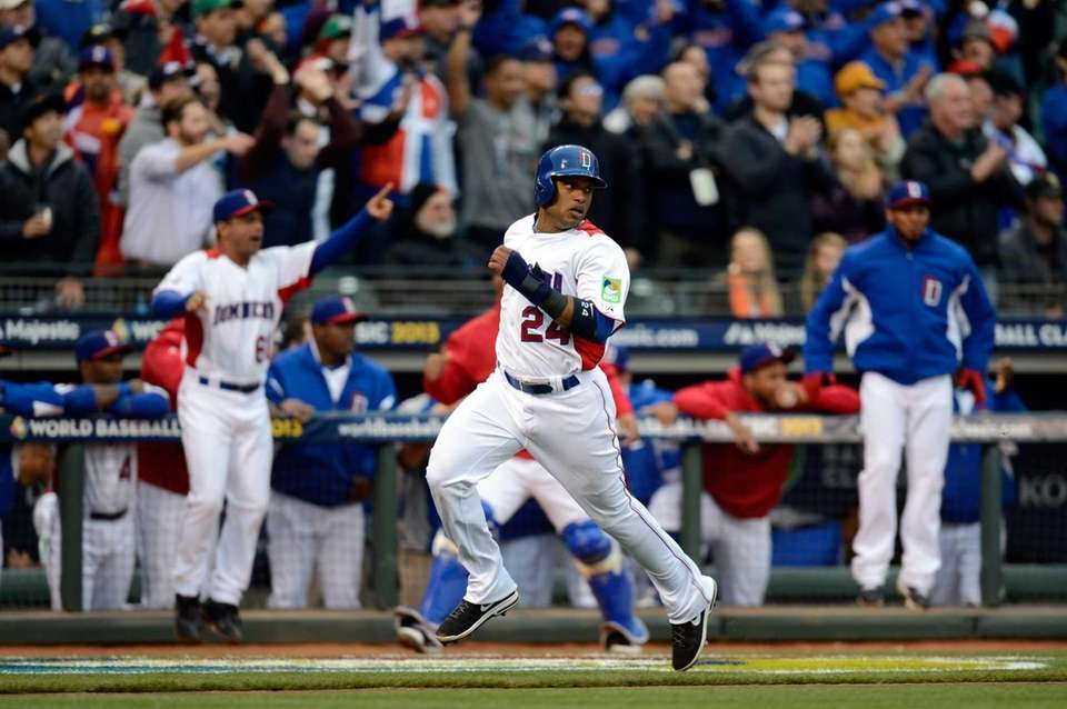 Robinson Cano #24 of the Dominican Republic scores