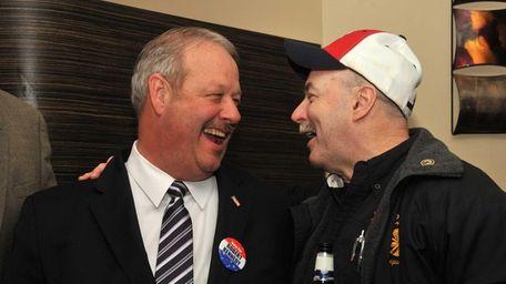 Freeport Mayoral race winner Robert Kennedy, left, celebrates