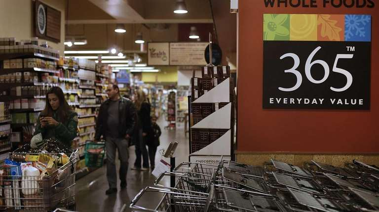 Customers shop at a Whole Foods Market Inc.