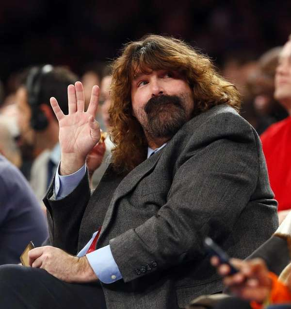 Wrestler Mick Foley attends the game between the