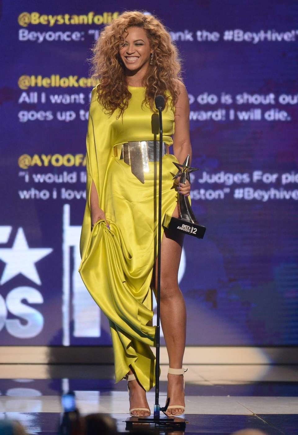 Singer Beyonce accepts the award for Best Female