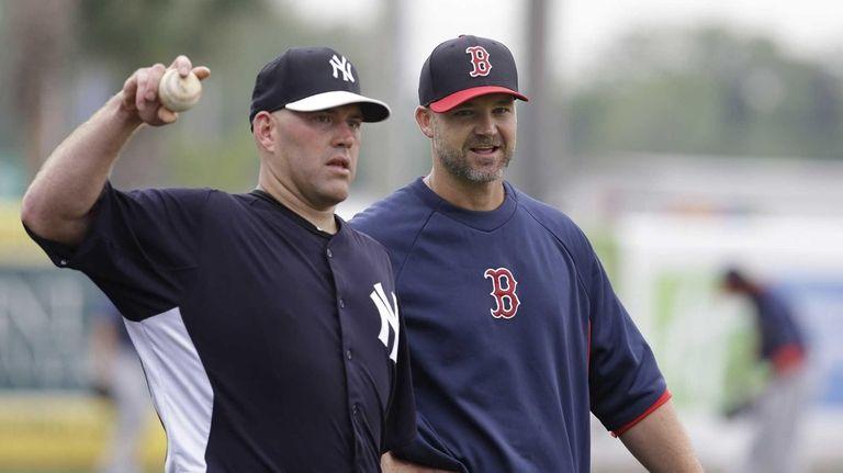 Yankees third baseman Kevin Youkilis, left, throws a