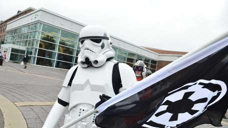 A storm trooper is seen walking past the