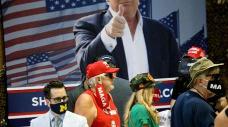 Supporters of President Donald Trump attend a campaign