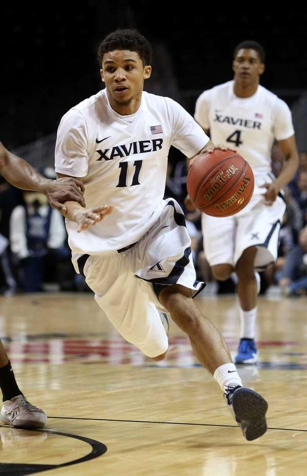 Xavier's Dee Davis drives to the basket against