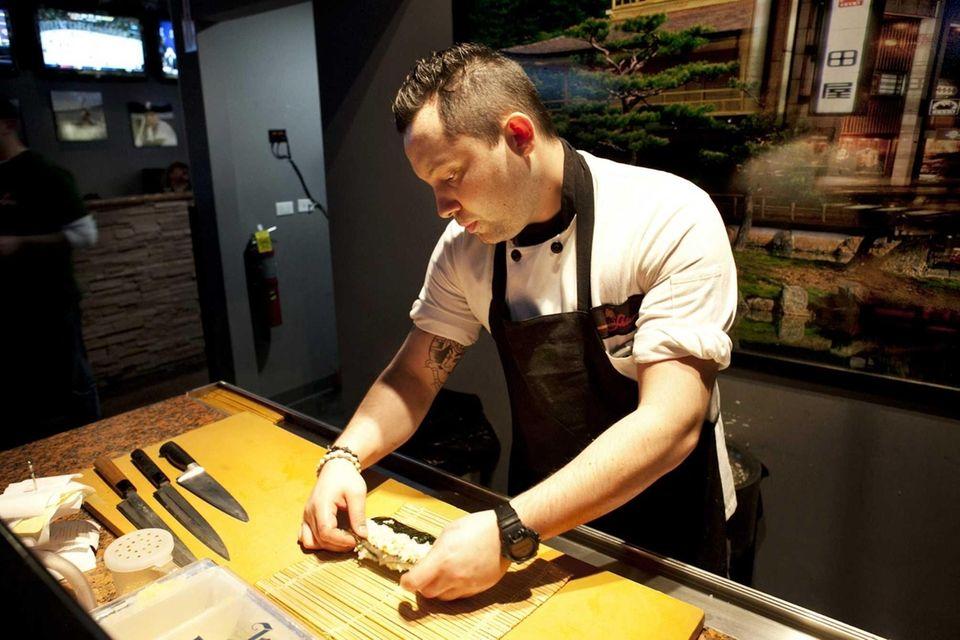 Sushi Chef Koji Kakimoto of Melville prepares a